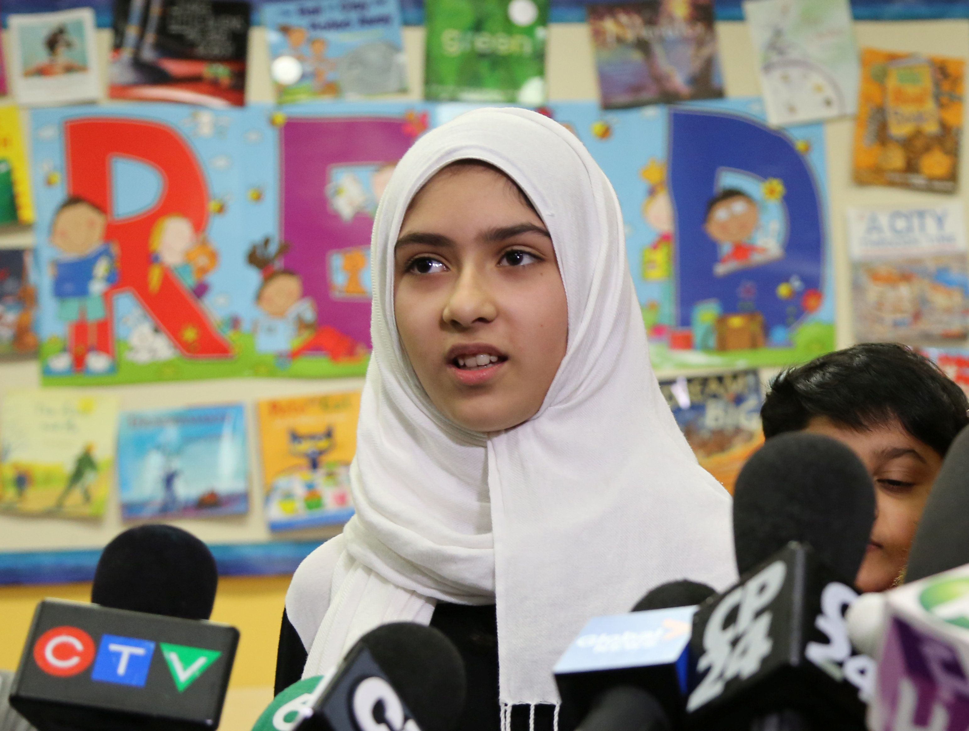 Khawlah Noman, 11, speaks to reporters at Pauline Johnson Junior Public School, after she told police that a man cut her hijab with scissors in Toronto, Ontario, Canada January 12, 2018. REUTERS/Chris Helgren