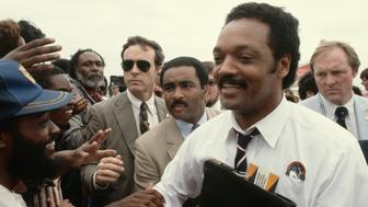 Jesse Jackson, Baptist minister and candidate for the Democratic presidential nomination in 1984, shakes hands with supporters during a campaign stop in Texas. (Photo by �� Jacques M. Chenet/CORBIS/Corbis via Getty Images)