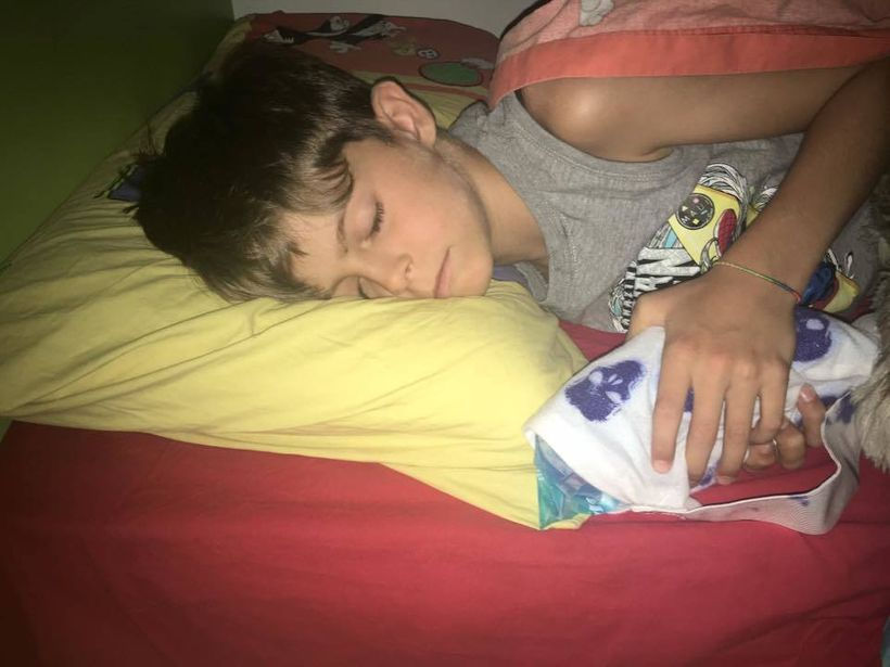Ascanio holding an icepack laying down