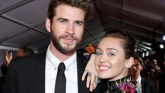 HOLLYWOOD, CA - OCTOBER 10:  Actor Liam Hemsworth (L) and Miley Cyrus at The World Premiere of Marvel Studios' 'Thor: Ragnarok' at the El Capitan Theatre on October 10, 2017 in Hollywood, California.  (Photo by Rich Polk/Getty Images for Disney)