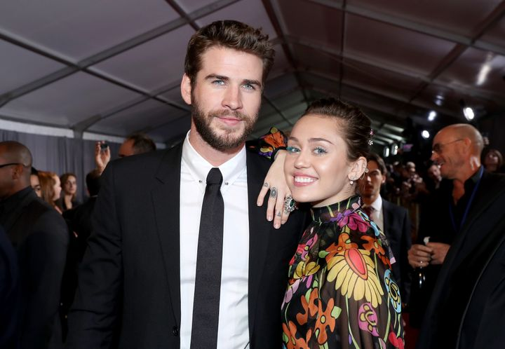 Miley Cyrus and Liam Hemsworth at a movie premiere in Hollywood on Oct. 10.