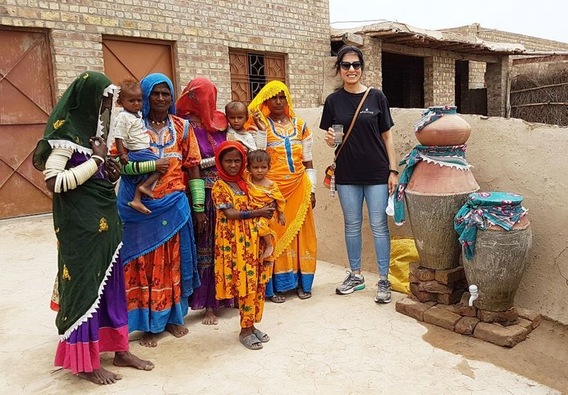<em>Mehreen with some recipients of her safe water project in the Thar Desert region in Sindh, Pakistan.</em>