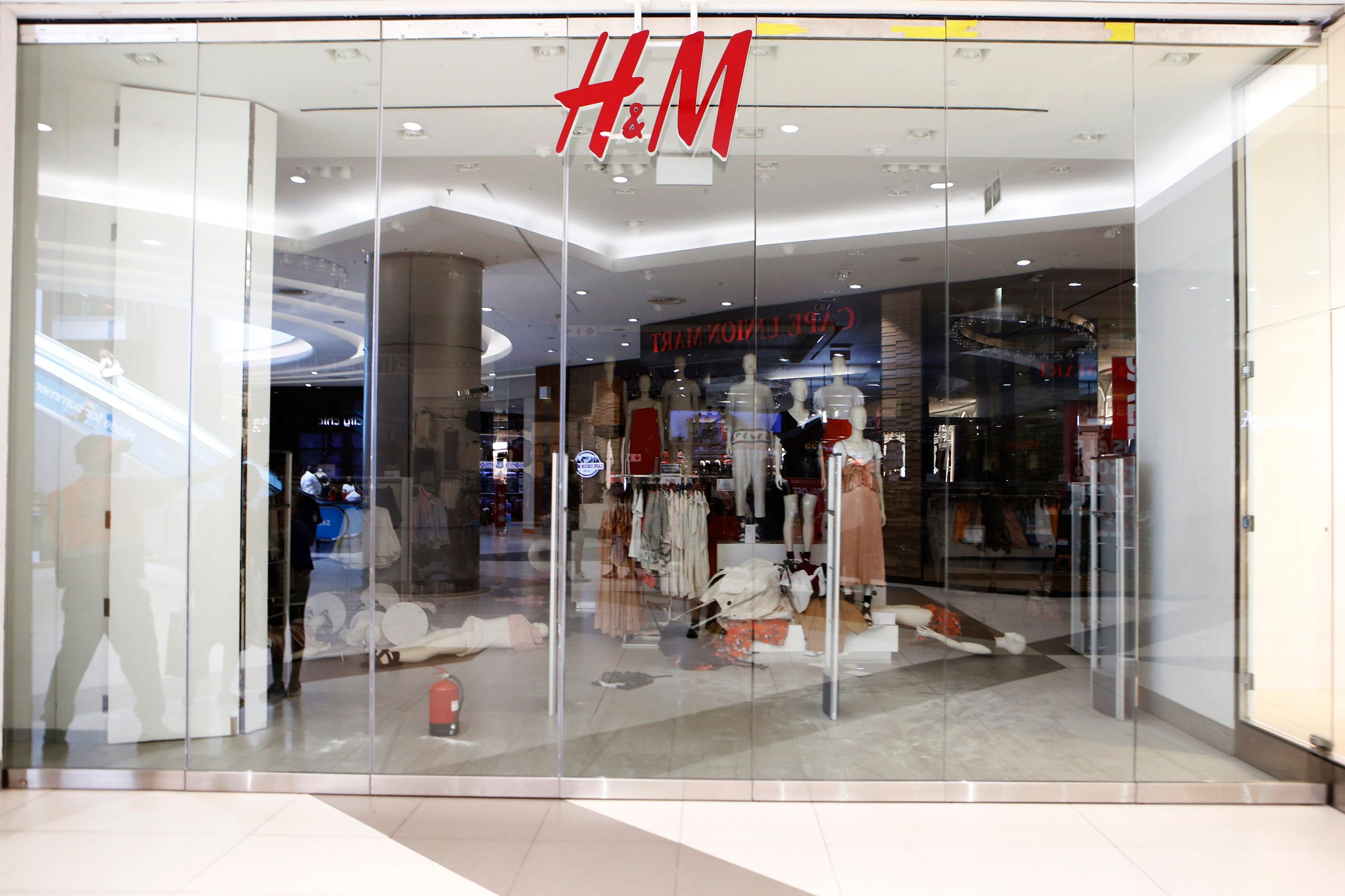Protesters trash H&M store as race row over 'coolest monkey in the jungle' featuring black child model continues to