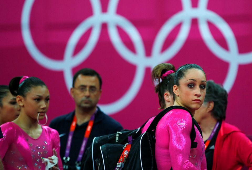 Larry Nassar and members of the U.S. national gymnastics team prepare the day before the London 2012...
