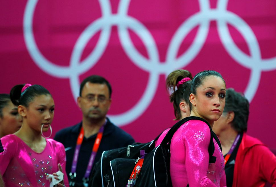 Larry Nassar and members of the U.S. national gymnastics team prepare the day before the London 2012 Olympic Games began.