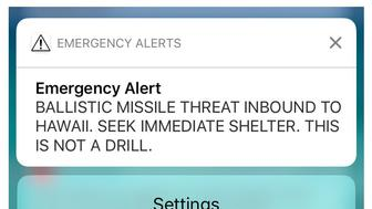 A combination photograph shows screenshots from a cell phone displaying an alert for a ballistic missile launch and the subsequent false alarm message in Hawaii January 13, 2018.  REUTERS/Hugh Gentry