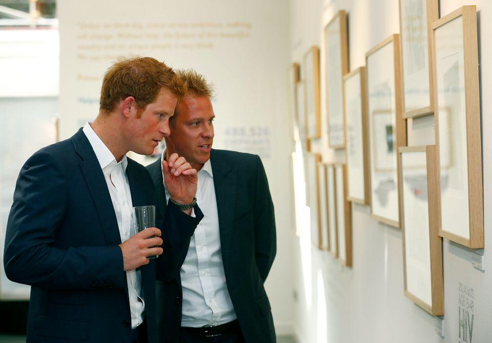 Prince Harry views Jackson's photographs of the Sentebale