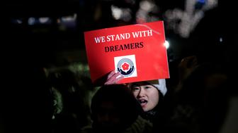 NEW YORK, NY - JANUARY 10: Activists rally for the passage of a 'clean' Dream Act, one without additional security or enforcement measures, outside the New York office of Sen. Chuck Schumer (D-NY), January 10, 2018 in New York City. The Dream Act, first introduced in 2001, is a proposed bill that would allow undocumented immigrants who came to the country as children to stay in the country legally. (Photo by Drew Angerer/Getty Images)