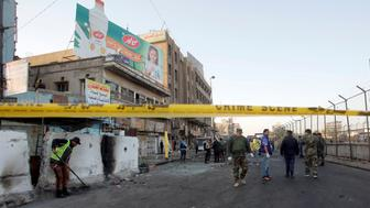 Iraqi security forces inspect the site of a bomb attack in Baghdad, Iraq January 15, 2018. REUTERS/Khalid al Mousily