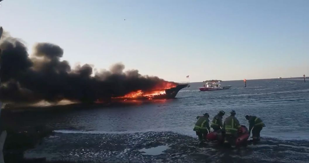 Firefighters on the scene of the casino boat fire.
