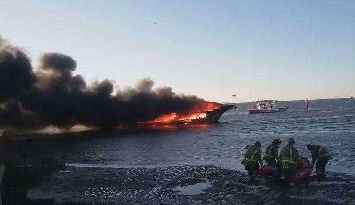 Firefighterson the sceneof the casino boat fire.