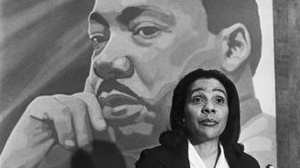 Coretta Scott King in front of a painting of Martin Luther King Jr.