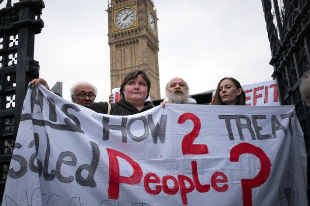Disability cuts campaigners outside