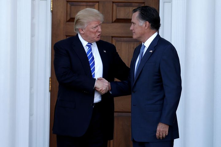 Former Massachusetts Gov. Mitt Romney (R) shakes hands with then President-elect Donald Trump following a meeting in New Jers