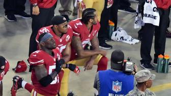 Sep 12, 2016; Santa Clara, CA, USA; San Francisco 49ers quarterback Colin Kaepernick and teammate 49ers free safety Eric Reid (35) kneel during the playing of the national anthem before a NFL game against the Los Angeles Rams at Levi's Stadium. Mandatory Credit: Kirby Lee-USA TODAY Sports