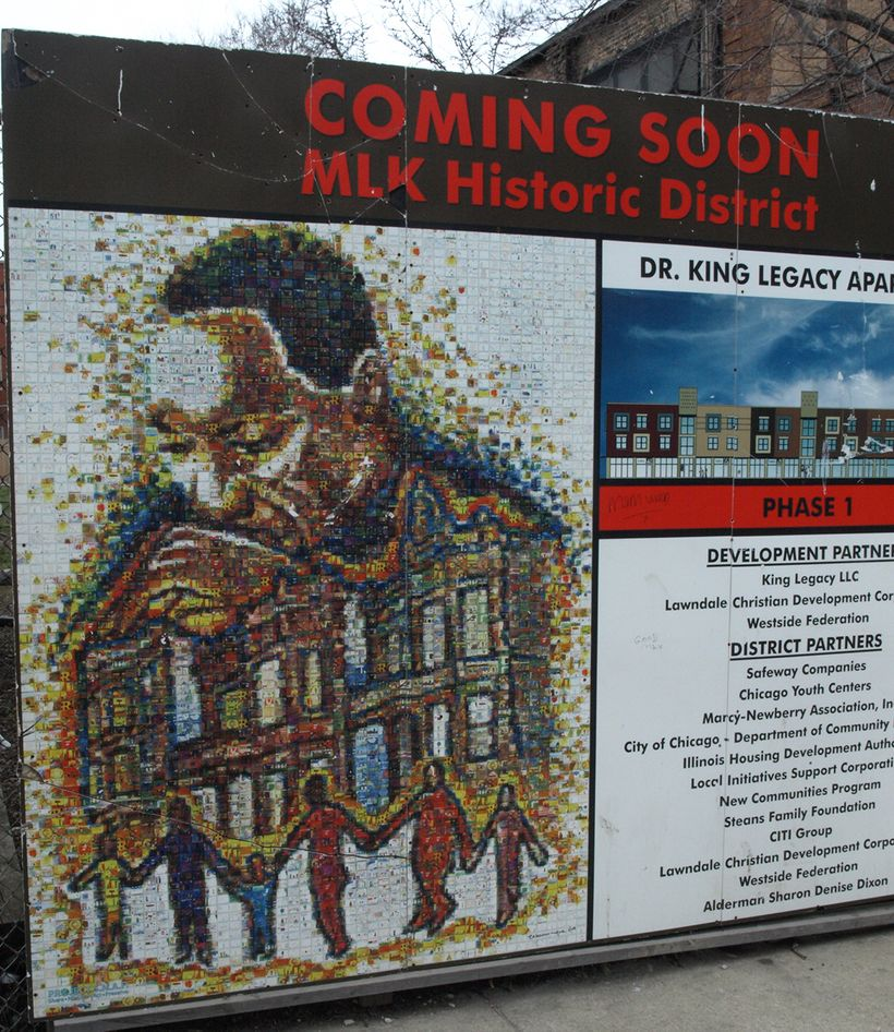 A sign marks the way for progress near the MLK Legacy apartments constructed on Chicago's West Side in the 1500 block of Sout
