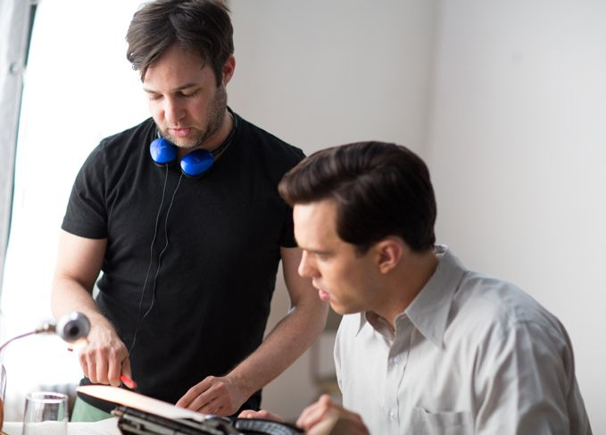 <strong>Writer/director Danny Strong on the set with star Nicholas Hoult</strong>