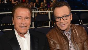 NASHVILLE, TN - JUNE 10:  Arnold Schwarzenegger (L) and Tom Arnold attend the 2015 CMT Music awards at the Bridgestone Arena on June 10, 2015 in Nashville, Tennessee.  (Photo by Kevin Mazur/WireImage)