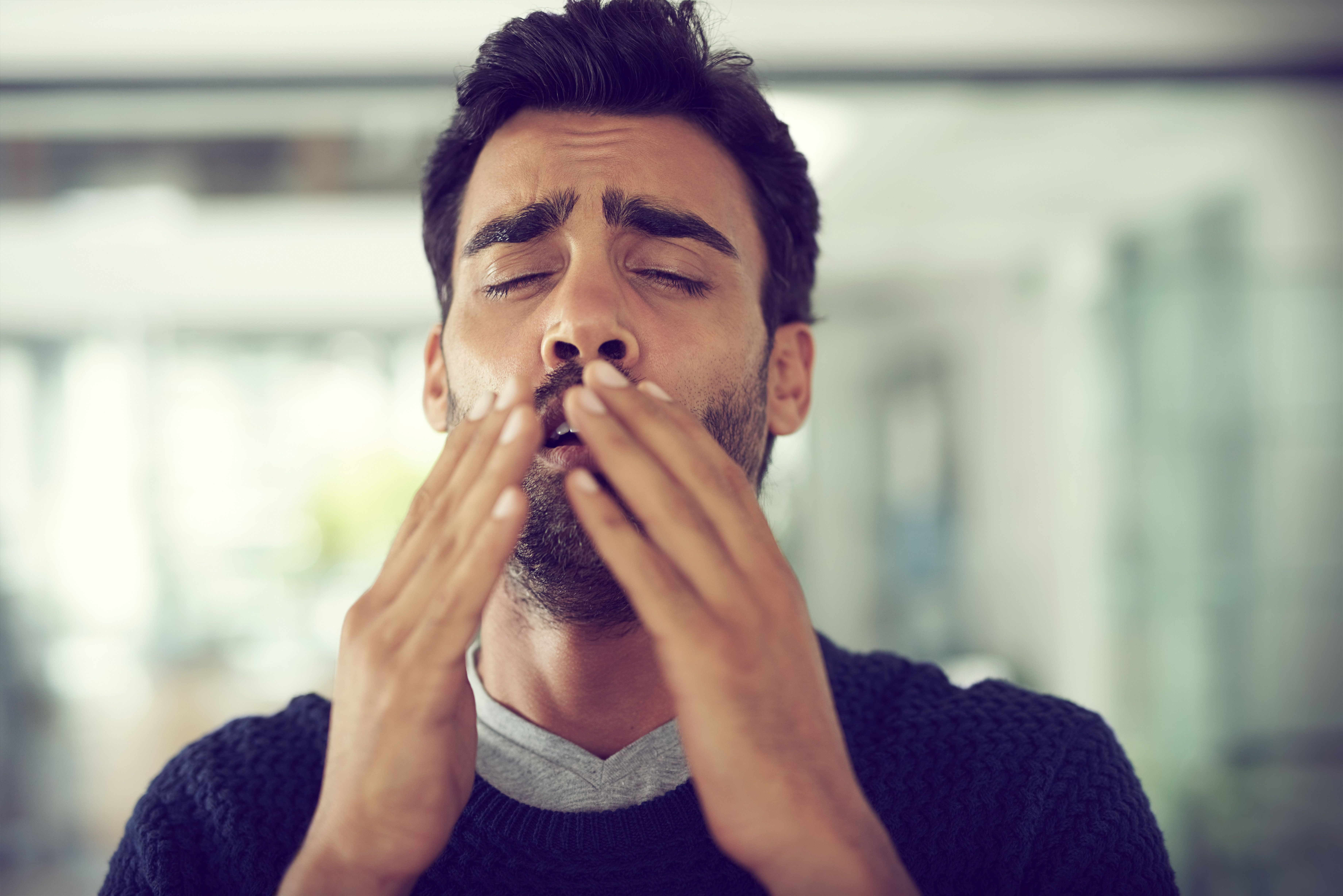 Man hospitalized after holding back sneeze