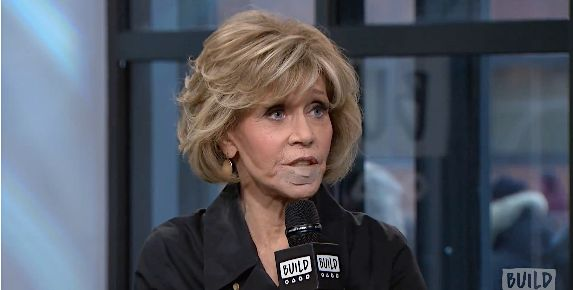 Jane Fonda quickly explained the bandage on her lip.