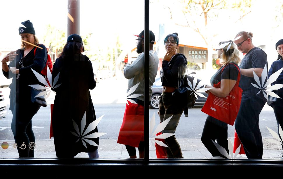 Customers line up in West Hollywood as the legal sale of recreational marijuanabegins in California.