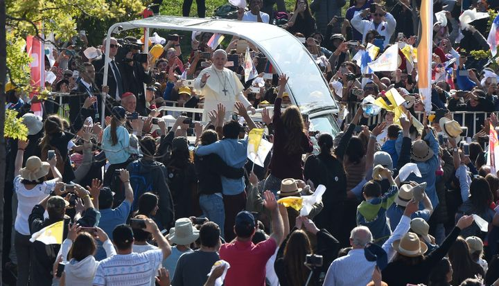 Pope Francis waves at the crowd from the popemobile as he arrives at O'Higgins Park in Santiago on January 16, 2018 to give a