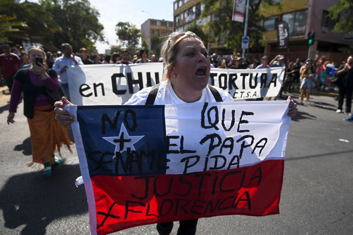 People demonstrate against the visit of Pope Francis to Chile.