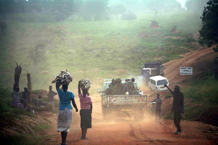 Ugandans internally displaced by fighting in November 2005 fetch water and firewood near Kitgum in the north of the coun