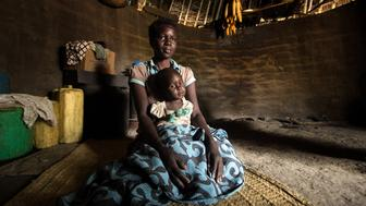 Abalo Monica, in her 20s, was one of the first identified with nodding syndrome in 1998. Her son, Otema, was conceived from rape but is healthy and shows no sign of the syndrome