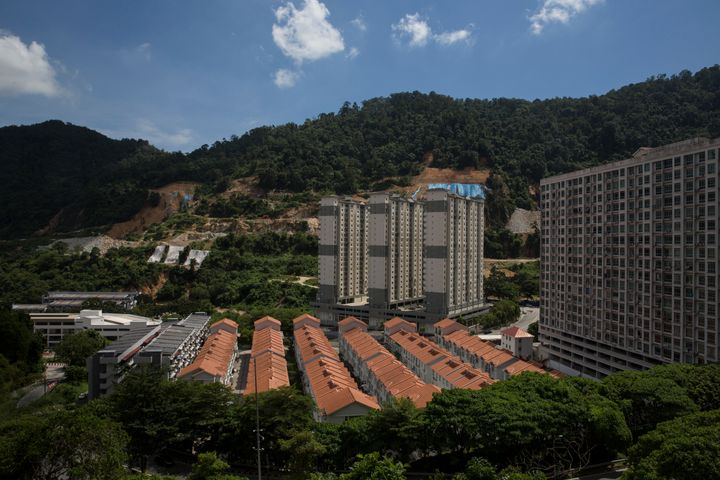 High-density condominiums and houses built on a newly cut hill in Penang.