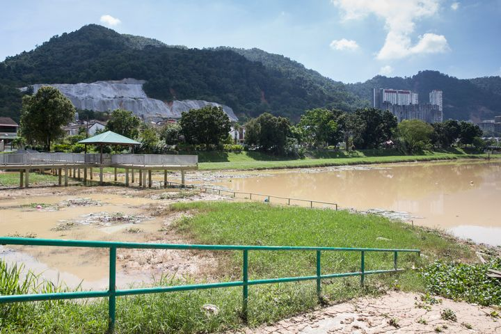 A lake in Penang muddied from flooding.
