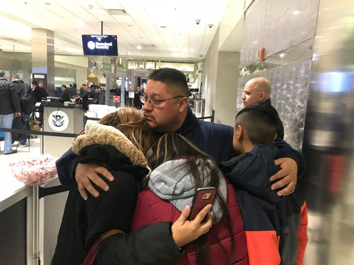 Jorge Garcia, 39, of Lincoln Park, Michigan, hugs his wife, Cindy Garcia, and their two children Jan. 15, 2018, at Detroit Me