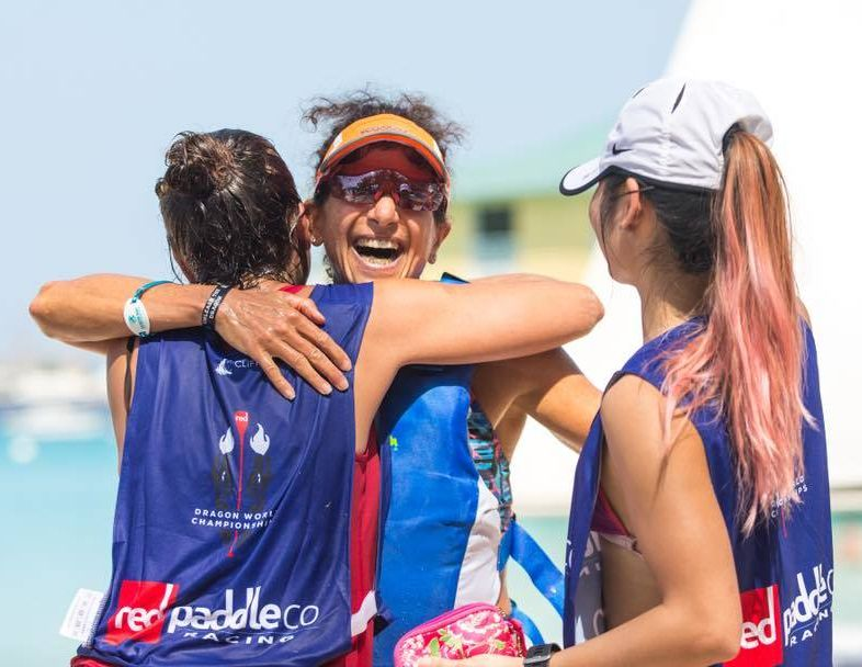 Stefani (author) finishing 9K Dragon Run with hugs from Red SUP Ladies.