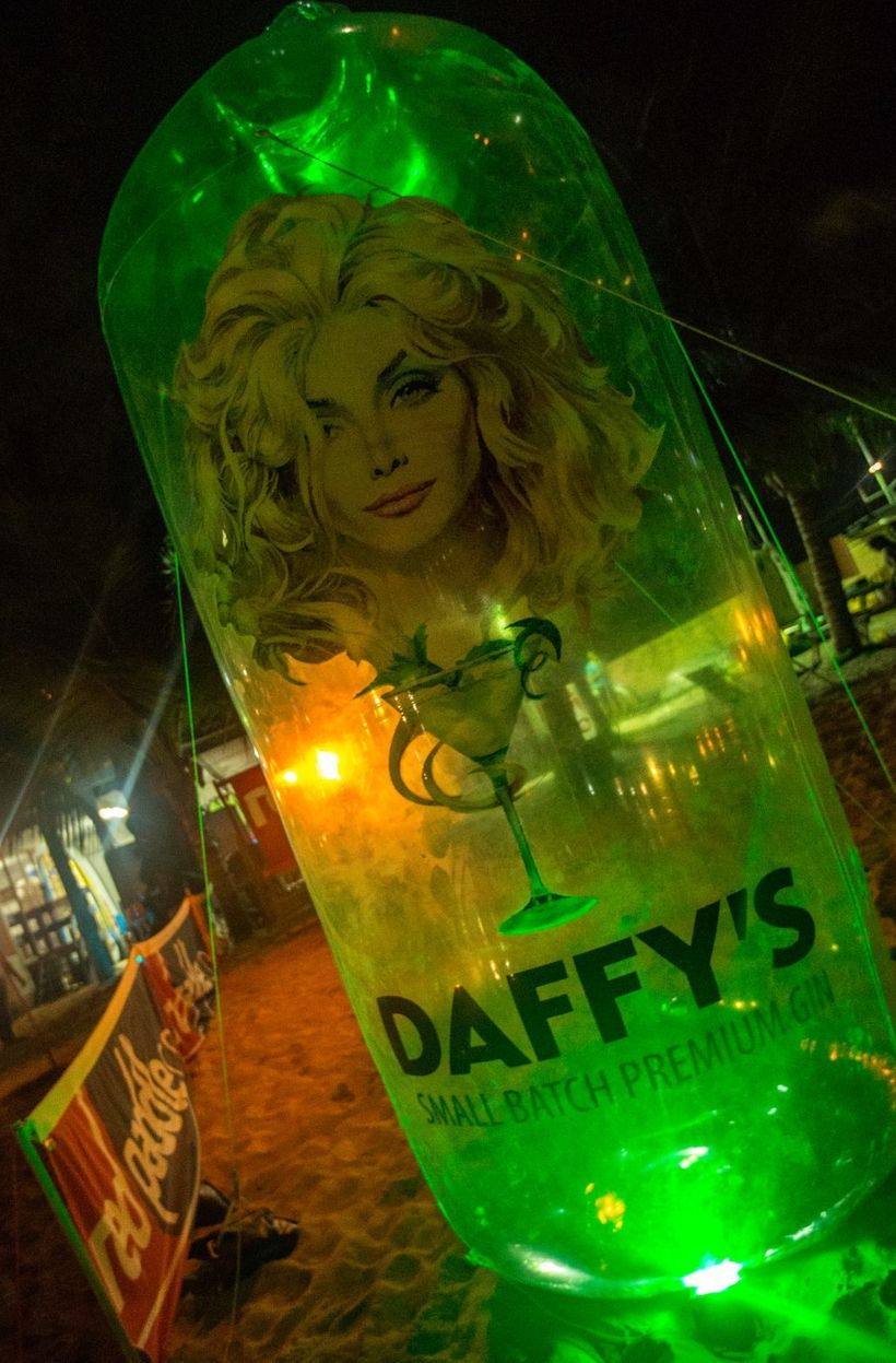 Giant Daffy's Gin blow up bottle adorning beach race site.