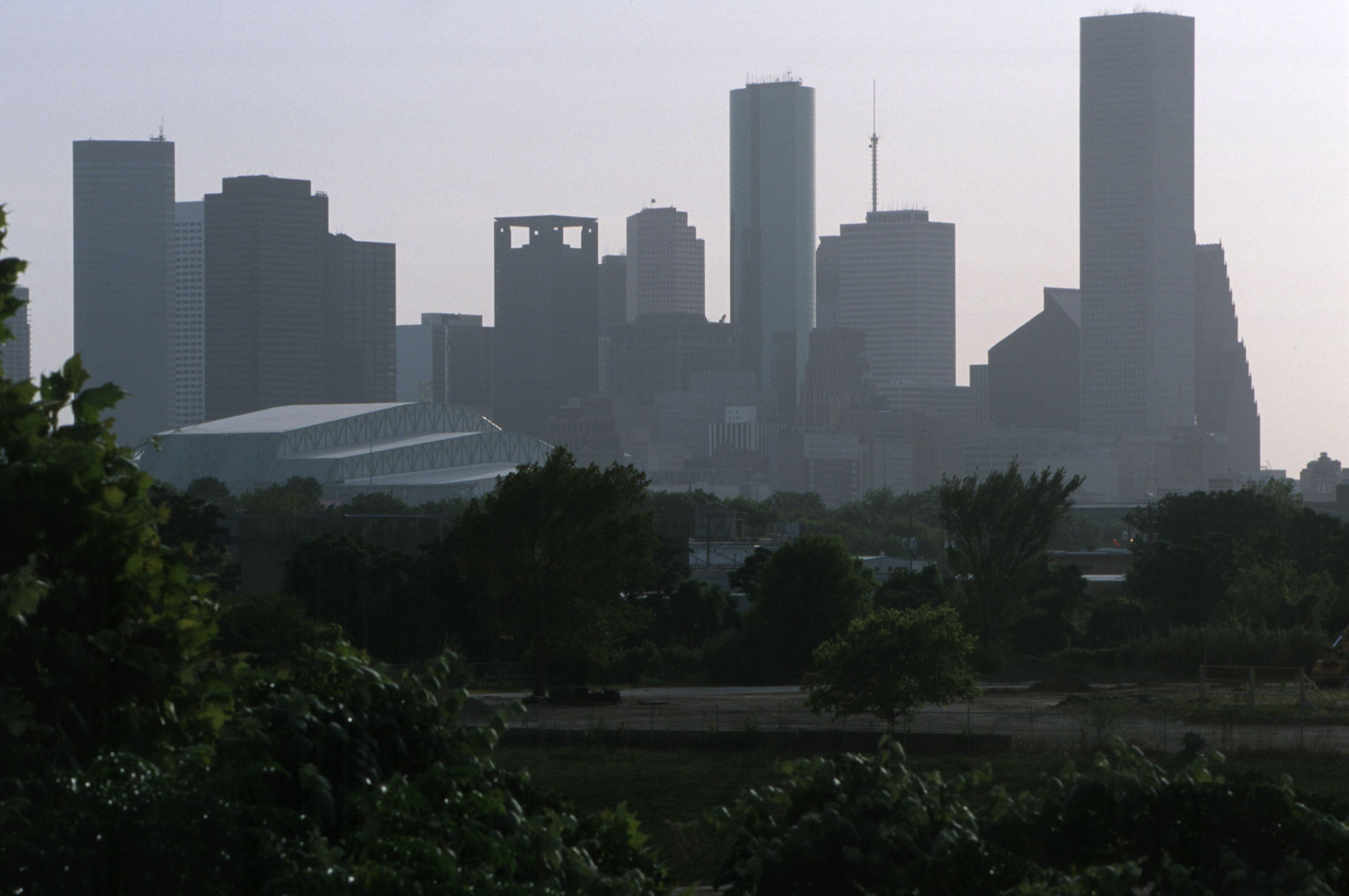 371682 01: Hazy smog blankets Houston, TX, June 26, 2000 during a hot summer day. According to the group Texas PEER, air quality in Texas has worsened significantly under Gov. George W. Bush's administration. The Houston-Galveston area has had eight of the top ten ozone (smog) peaks in the nation, far surpassing Los Angeles. PEER accuses Bush of choosing to bypass clean air regulations rather than enforce them. When research showed that 1,000 unregulated 'grandfathered' industrial plants accounted for a huge proportion of Texas air pollution, Bush opposed legislation that would force the companies to clean up, instead choosing to offer a 'voluntary' program. The heads of these companies include some of Bush's largest campaign contributors, says the Texas PEER group. (Photo by Joe Raedle/Newsmakers)