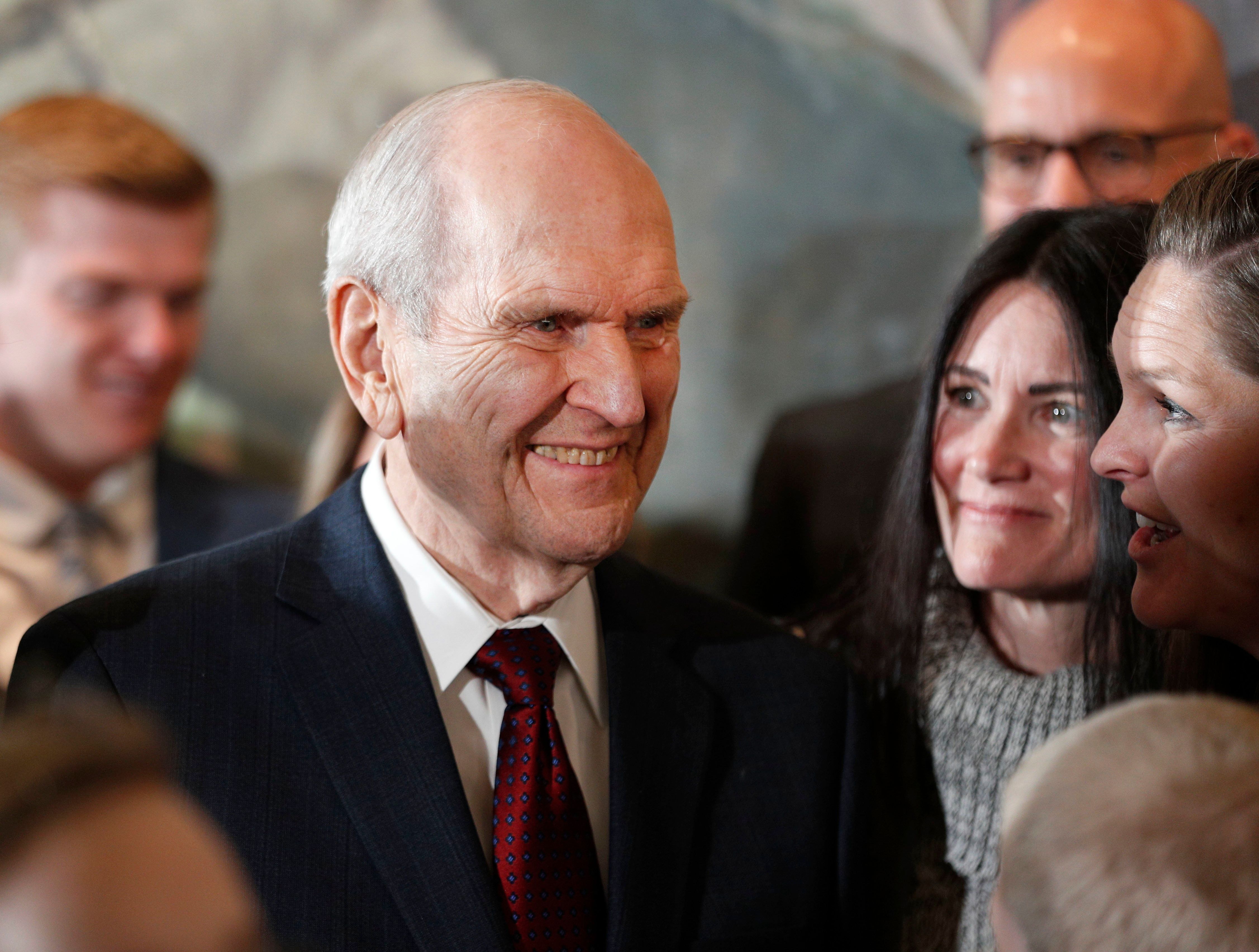 Russell M. Nelson, 93, the new president of the Church of Jesus Christ of Latter-Day Saints, greets family members after a pr