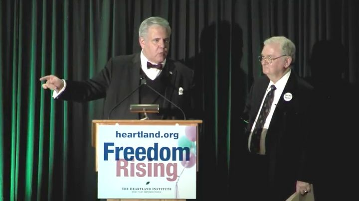 Joseph Morris, left, delivering a speech at the Heartland Institute's 32nd Anniversary Benefit Dinner in September 2016.