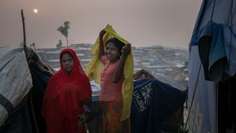 COX'S BAZAR, BANGLADESH - JANUARY 14: Rohingya refugees are seen in Balukhali camp on January 14, 2018 in Cox's Bazar, Bangladesh. Over 650,000 Rohingya have crossed the border to Bangladesh since August last year, fleeing the violence at Rakhine State when their villages were attacked and many worry that they will face further reprisals if they return to Myanmar. The refugee camps in Bangladesh no longer seem temporary as thousands of tents made of plastic and bamboo spread across the undulating terrain and long wooden bridges connect parts of the camps divided by water. Existing camps such as Nayapara and Kutupalong have swelled to accommodate the new arrivals since the Myanmar military began its campaign in late August while the Rohingya queue for hours to get rations due to little access to clean water, health care or food and the refugee camps turn into mud-baths whenever it rains. International aid groups and health workers have estimated at least 6,700 Rohingya had met with violent deaths and warn of potential outbreaks of cholera and other preventable diseases due to squalid conditions. (Photo by Allison Joyce/Getty Images)