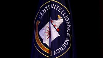 "The Central Intelligence Agency (CIA) flag is displayed on stage during a conference on national security entitled ""The Ethos and Profession of Intelligence"" in Washington October 27, 2015. REUTERS/Yuri Gripas"