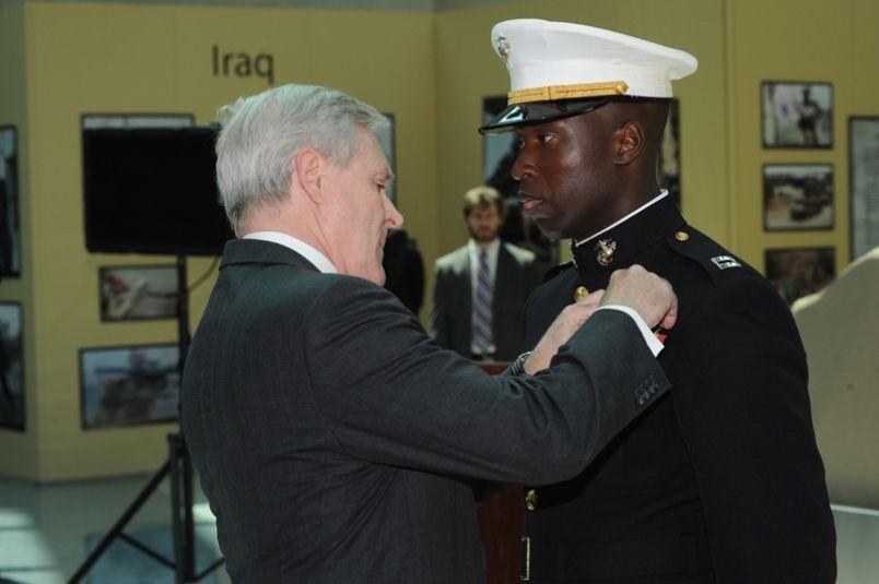 <em>Capt. Ademola Fabayo receiving the Navy Cross. )</em>