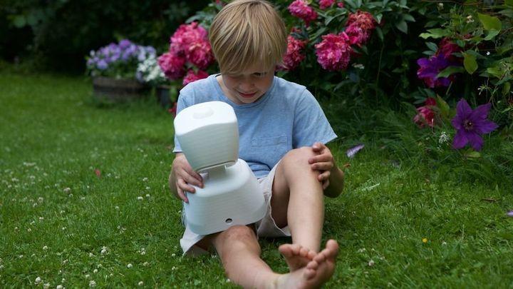 A child who has a long-term illness communicating through his robot.