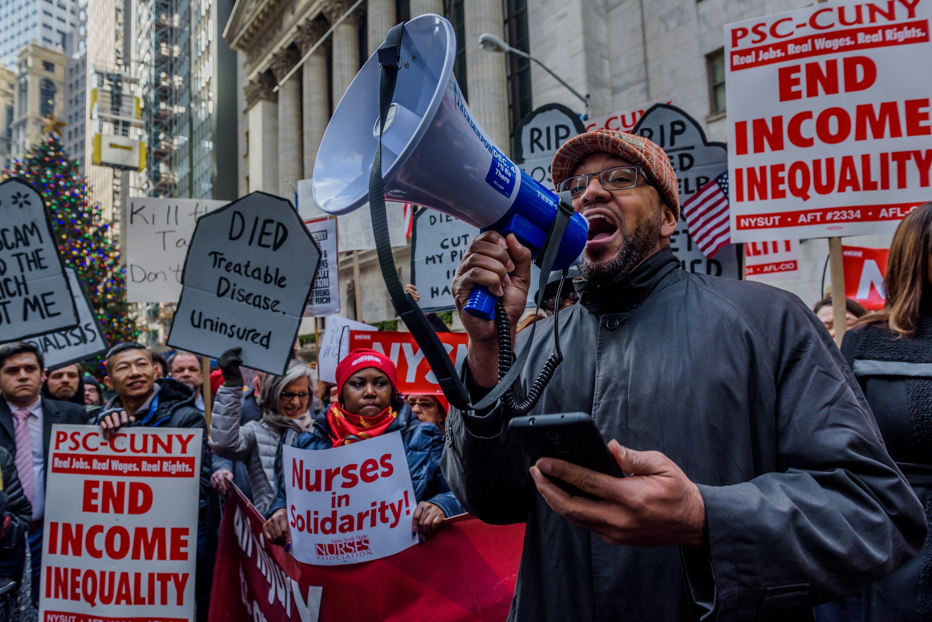 """Protestersgathered outside the New York Stock Exchange in December chanting """"Kill the Bill. Don't Kill Us!&"""