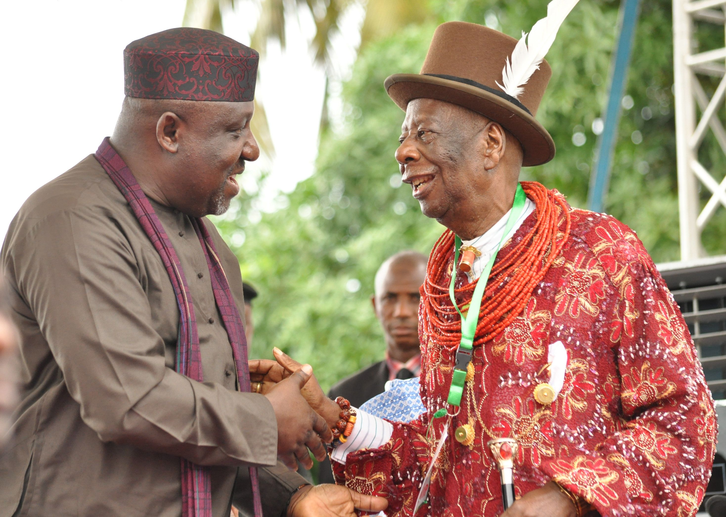 Paramout ruler of Ogoniland King Godwin Gininwa (R) shakes hand with Imo State Governor Rochas Okorocha during the launch of a clean up operation of Ogoniland, on June 2, 2016 in the Ogoniland area of Rivers state in the Niger Delta region. Nigeria's vice-president Yemi Osinbajo launched a $1 billion oil pollution clean-up programme in the Niger delta, after President Muhammadu Buhari pulled out of visiting the restive region. Yemi Osinbajo stood in for Buhari, who had been due to attend the ceremony in the Ogoniland area of Rivers state in what would have been his first visit to the delta as president. / AFP / STRINGER        (Photo credit should read STRINGER/AFP/Getty Images)
