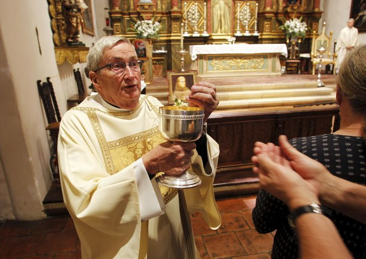 A deacon distributes the Eucharist during Mass at the Carmel Mission Basilica in Carmel, California, on Sept. 23, 2015.