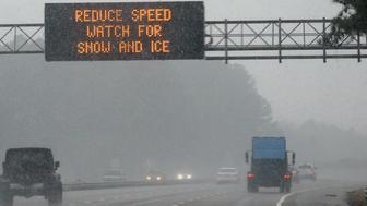 MORRISVILLE, NC - JANUARY 17: An electronic sign reads 'REDUCE SPEED WATCH FOR SNOW AND ICE' as vehicles move along Interstate 40 on January 17, 2018 in Morrisville, North Carolina. Governor Roy Cooper declared a State of Emergency yesterday ahead of the winter storm. (Photo by Lance King/Getty Images)