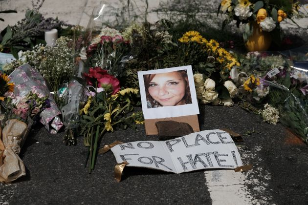 Flowers and a photo of car-ramming victim Heather Heyer lie at a makeshift memorial in Charlottesville,