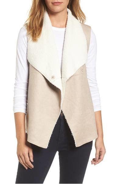 "Throw this <a href=""https://shop.nordstrom.com/s/dylan-faux-shearling-backed-knit-vest/4730642?origin=keywordsearch&keywo"