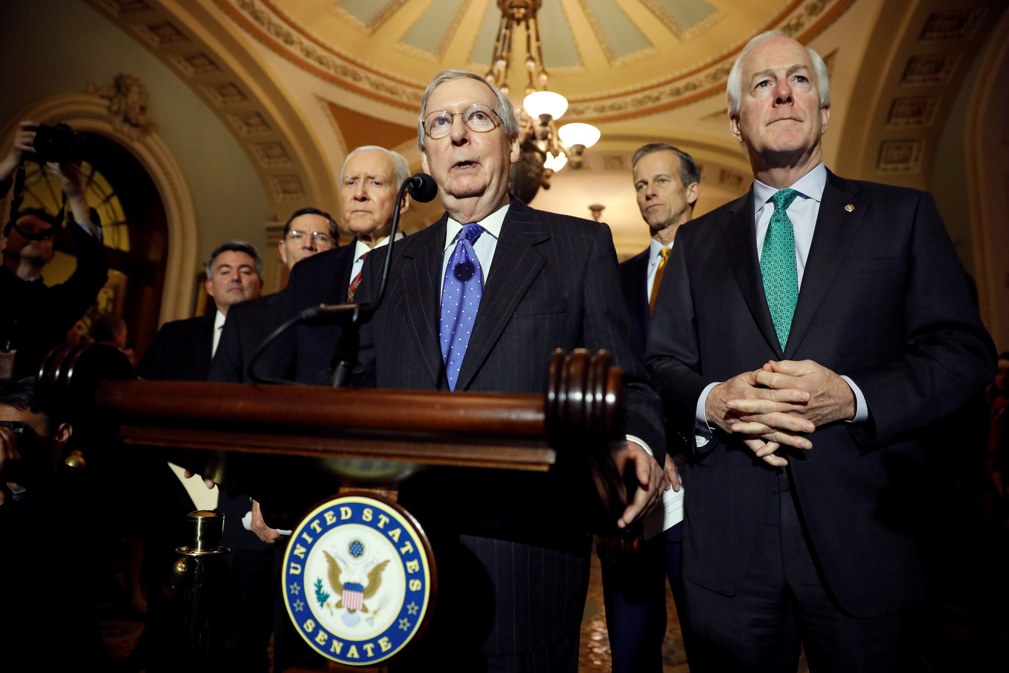 Senate Majority Leader Mitch McConnell, accompanied by, from left to right, Sen. Cory Gardner (R-CO), Sen. John Barrasso (R-WY), Sen. Orrin Hatch (R-UT), Sen. John Thune (R-SD), and Sen. John Cornyn (R-TX), speaks about the Tax Cuts and Jobs Acts at news conference following the weekly policy luncheons at the U.S. Capitol in Washington, U.S., December 19, 2017. REUTERS/Aaron P. Bernstein