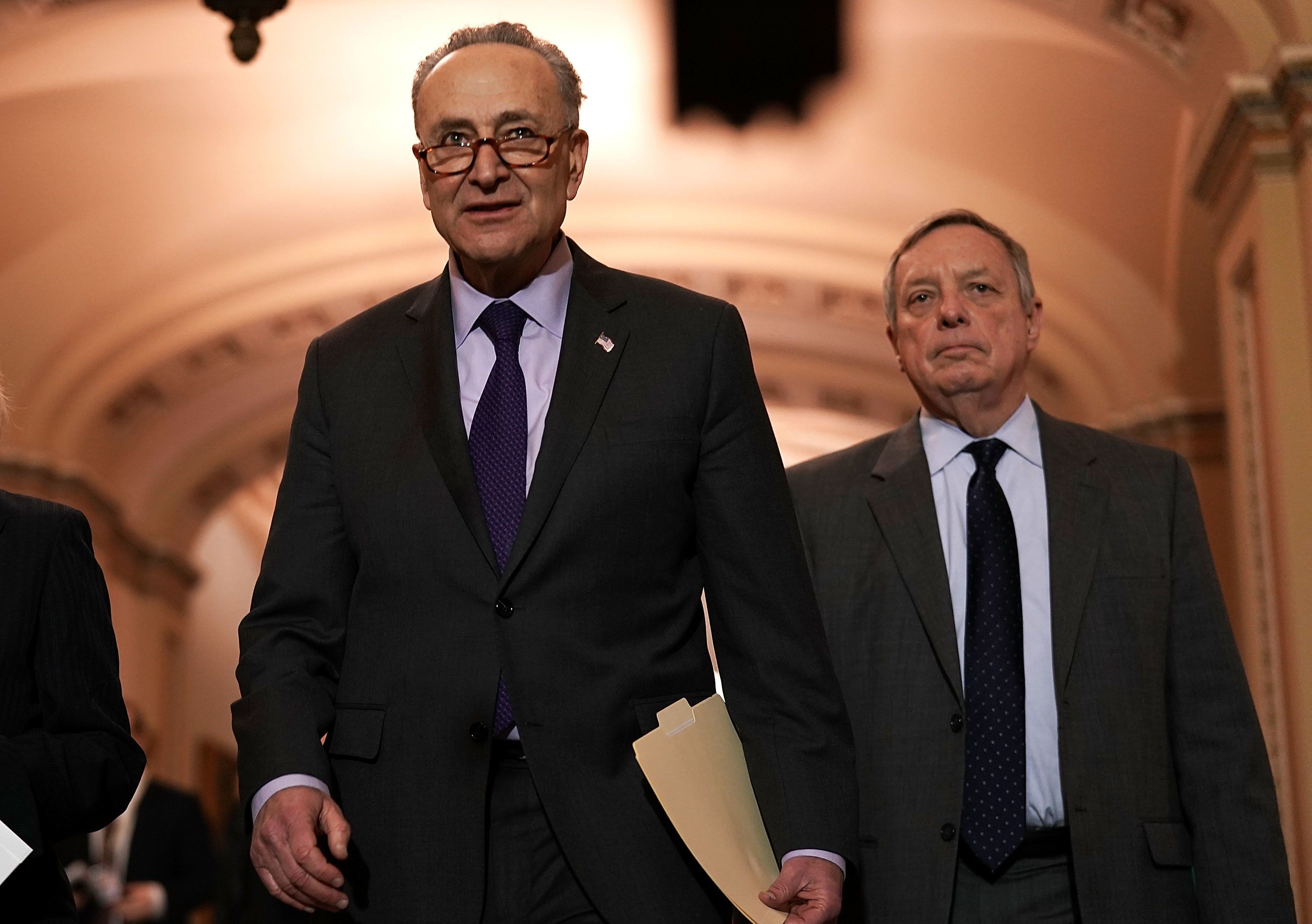 WASHINGTON, DC - JANUARY 17:  U.S. Senate Minority Leader Sen. Chuck Schumer (D-NY) (L) and Senate Minority Whip Sen. Dick Durbin (D-IL) (R) approach the podium to speak to members of the media after a Senate Democratic Policy Luncheon January 17, 2018 at the Capitol in Washington, DC. Senate Democrats held the weekly luncheon to discuss Democratic agenda.  (Photo by Alex Wong/Getty Images)