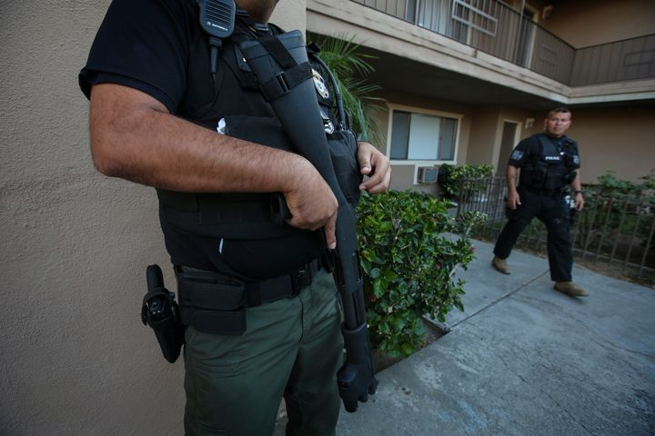 ICE agents carry out a raid to apprehend undocumented immigrants in Riverside, California, last year.